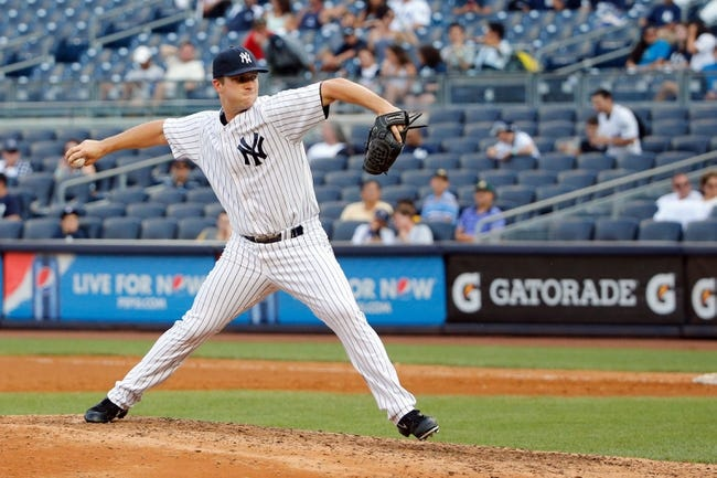 Sep 2, 2013; Bronx, NY, USA;  New York Yankees relief pitcher Adam Warren (43) delivers a pitch during the ninth inning against the Chicago White Sox at Yankee Stadium. Yankees won 9-1.  Mandatory Credit: Anthony Gruppuso-USA TODAY Sports
