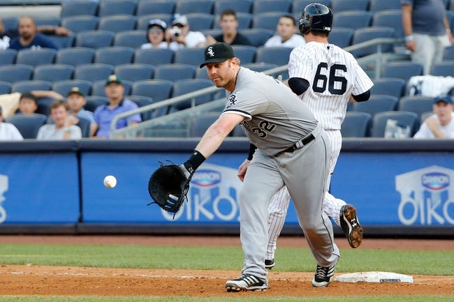 Sep 2, 2013; Bronx, NY, USA;  New York Yankees catcher J.R. Murphy (66) steps safely to first as Chicago White Sox first baseman Adam Dunn (32) waits for the ball during the eighth inning at Yankee Stadium. Yankees won 9-1.  Mandatory Credit: Anthony Gruppuso-USA TODAY Sports