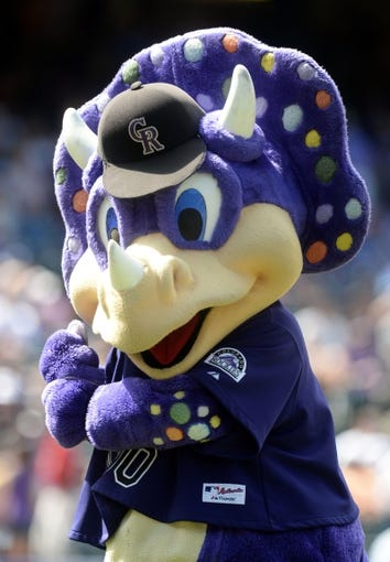 Sept 2, 2013; Denver, CO, USA; Colorado Rockies mascot Dinger during the game against the Los Angeles Dodgers at Coors Field. Mandatory Credit: Ron Chenoy-USA TODAY Sports