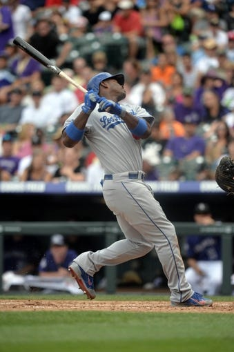 Sept 2, 2013; Denver, CO, USA; Los Angeles Dodgers right fielder Yasiel Puig (66) react to being hit by a pitch in the fourth inning against the Colorado Rockies at Coors Field. Mandatory Credit: Ron Chenoy-USA TODAY Sports