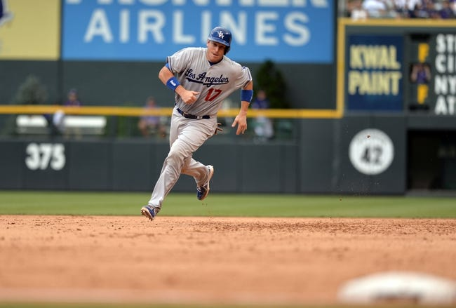 Sept 2, 2013; Denver, CO, USA; Los Angeles Dodgers catcher A.J. Ellis (17) runs to third base in the fifth inning against the Colorado Rockies at Coors Field. Mandatory Credit: Ron Chenoy-USA TODAY Sports
