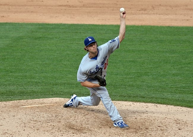 Sept 2, 2013; Denver, CO, USA; Los Angeles Dodgers starting pitcher Clayton Kershaw (22) delivers a pitch in the fifth inning against the Colorado Rockies at Coors Field. Mandatory Credit: Ron Chenoy-USA TODAY Sports