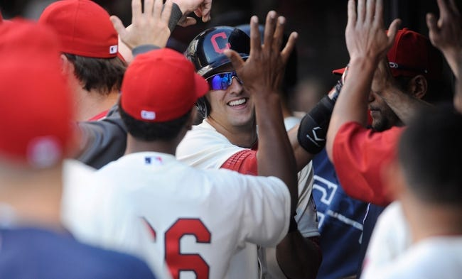 Sep 2, 2013; Cleveland, OH, USA; Cleveland Indians third baseman Lonnie Chisenhall (8) is congratulated after hitting a home run during the eighth inning against the Baltimore Orioles at Progressive Field. The Orioles beat the Indians 7-2. Mandatory Credit: Ken Blaze-USA TODAY Sports