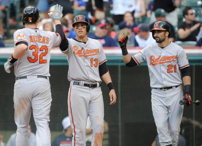 Sep 2, 2013; Cleveland, OH, USA; Baltimore Orioles catcher Matt Wieters (32) is congratulated by Baltimore Orioles third baseman Manny Machado (13) and Baltimore Orioles right fielder Nick Markakis (21) after a two-run home run against the Cleveland Indians during the ninth inning at Progressive Field. The Orioles beat the Indians 7-2. Mandatory Credit: Ken Blaze-USA TODAY Sports