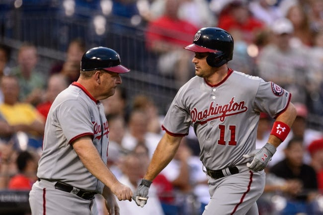 Sep 2, 2013; Philadelphia, PA, USA;  Washington Nationals third baseman Ryan Zimmerman (11) celebrates hitting a home run with third base coach Trent Jewett during the first inning against the Philadelphia Phillies at Citizens Bank Park. Mandatory Credit: Howard Smith-USA TODAY Sports
