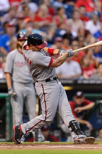 Sep 2, 2013; Philadelphia, PA, USA;  Washington Nationals third baseman Ryan Zimmerman (11) hits a home run during the first inning against the Philadelphia Phillies at Citizens Bank Park. Mandatory Credit: Howard Smith-USA TODAY Sports