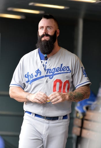 Sept 2, 2013; Denver, CO, USA; Los Angeles Dodgers relief pitcher Brian Wilson (00) in the dugout in the seventh inning against the Colorado Rockies at Coors Field. The Dodgers defeated the Rockies 10-8. Mandatory Credit: Ron Chenoy-USA TODAY Sports