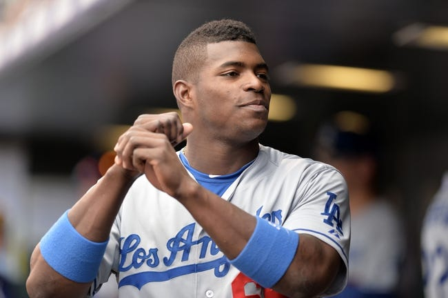 Sept 2, 2013; Denver, CO, USA; Los Angeles Dodgers right fielder Yasiel Puig (66) during the game against the Colorado Rockies at Coors Field. The Dodgers defeated the Rockies 10-8. Mandatory Credit: Ron Chenoy-USA TODAY Sports
