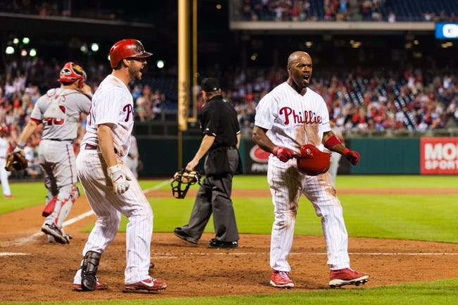 Sep 2, 2013; Philadelphia, PA, USA; Philadelphia Phillies shortstop Jimmy Rollins (11) celebrates scoring during the eighth inning against the Washington Nationals at Citizens Bank Park. The Phillies defeated the Nationals 3-2. Mandatory Credit: Howard Smith-USA TODAY Sports
