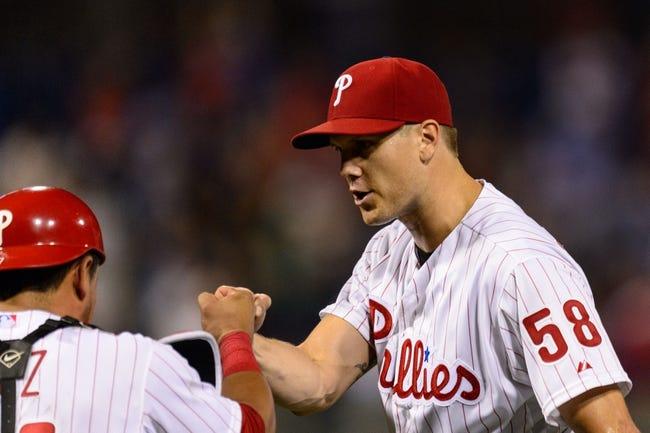 Sep 2, 2013; Philadelphia, PA, USA; Philadelphia Phillies pitcher Jonathan Papelbon (58) celebrates with catcher Carlos Ruiz (51) after pitching the ninth inning against the Washington Nationals at Citizens Bank Park. The Phillies defeated the Nationals 3-2. Mandatory Credit: Howard Smith-USA TODAY Sports