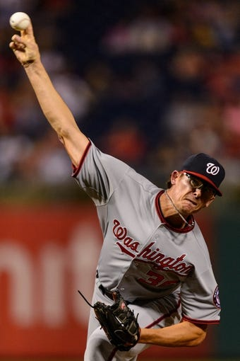 Sep 2, 2013; Philadelphia, PA, USA; Washington Nationals pitcher Tyler Clippard (36) delivers to the plate during the eighth inning against the Philadelphia Phillies at Citizens Bank Park. The Phillies defeated the Nationals 3-2. Mandatory Credit: Howard Smith-USA TODAY Sports