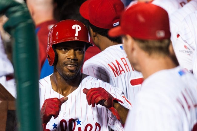 Sep 2, 2013; Philadelphia, PA, USA; Philadelphia Phillies shortstop Jimmy Rollins (11) celebrates scoring with pitcher Roy Halladay (34) during the fourth inning against the Washington Nationals at Citizens Bank Park. The Phillies defeated the Nationals 3-2. Mandatory Credit: Howard Smith-USA TODAY Sports