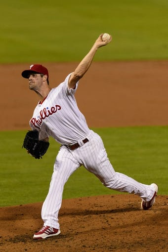 Sep 2, 2013; Philadelphia, PA, USA; Philadelphia Phillies pitcher Cole Hamels (35) delivers to the plate during the third inning against the Washington Nationals at Citizens Bank Park. The Phillies defeated the Nationals 3-2. Mandatory Credit: Howard Smith-USA TODAY Sports