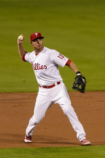 Sep 2, 2013; Philadelphia, PA, USA; Philadelphia Phillies third baseman Pete Orr (12) throws to first base during the third inning against the Washington Nationals at Citizens Bank Park. The Phillies defeated the Nationals 3-2. Mandatory Credit: Howard Smith-USA TODAY Sports