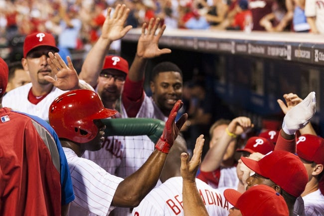 Sep 2, 2013; Philadelphia, PA, USA; Philadelphia Phillies shortstop Jimmy Rollins (11) celebrates scoring with teammates  during the eighth inning against the Washington Nationals at Citizens Bank Park. The Phillies defeated the Nationals 3-2. Mandatory Credit: Howard Smith-USA TODAY Sports