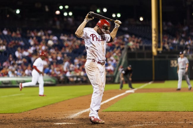 Sep 2, 2013; Philadelphia, PA, USA; Philadelphia Phillies first baseman Kevin Frandsen (28) hits himself in the head with his bat after striking out during the eighth inning against the Washington Nationals at Citizens Bank Park. The Phillies defeated the Nationals 3-2. Mandatory Credit: Howard Smith-USA TODAY Sports