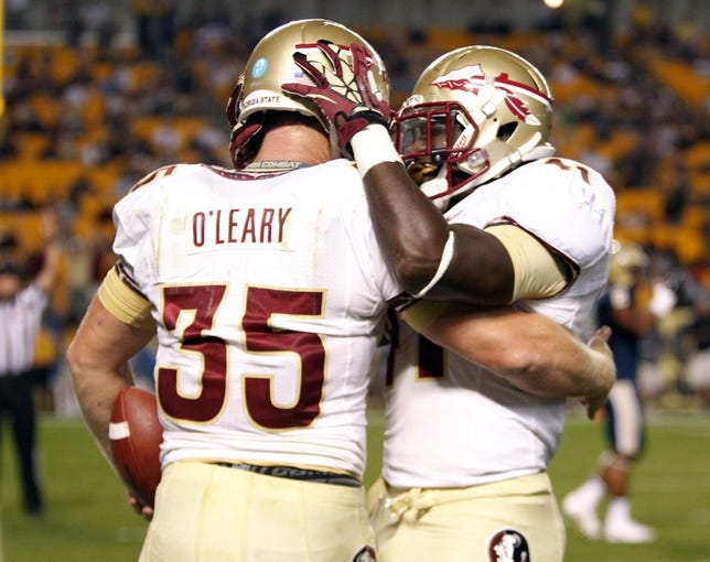 Sep 2, 2013; Pittsburgh, PA, USA; Florida State Seminoles tight end Nick O'Leary (35) and fullback Chad Abram (41) celebrate after O'Leary scored a touchdown against the Pittsburgh Panthers during the fourth quarter at Heinz Field. The Florida State Seminoles won 41-13. Mandatory Credit: Charles LeClaire-USA TODAY Sports