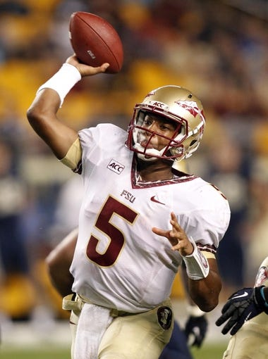 Sep 2, 2013; Pittsburgh, PA, USA; Florida State Seminoles quarterback Jameis Winston (5) passes the ball against the Pittsburgh Panthers during the fourth quarter at Heinz Field. The Florida State Seminoles won 41-13. Mandatory Credit: Charles LeClaire-USA TODAY Sports
