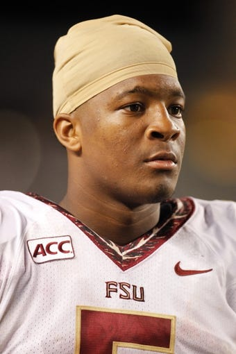 Sep 2, 2013; Pittsburgh, PA, USA; Florida State Seminoles quarterback Jameis Winston (5) looks on from the sidelines against the Pittsburgh Panthers during the fourth quarter at Heinz Field. The Florida State Seminoles won 41-13. Mandatory Credit: Charles LeClaire-USA TODAY Sports