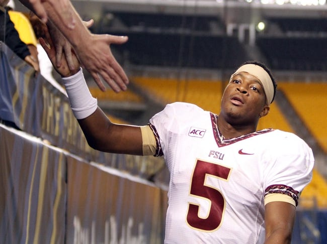 Sep 2, 2013; Pittsburgh, PA, USA; Florida State Seminoles quarterback Jameis Winston (5) receives congratulations from fans as he leaves the field after playing the Pittsburgh Panthers at Heinz Field. The Florida State Seminoles won 41-13. Mandatory Credit: Charles LeClaire-USA TODAY Sports
