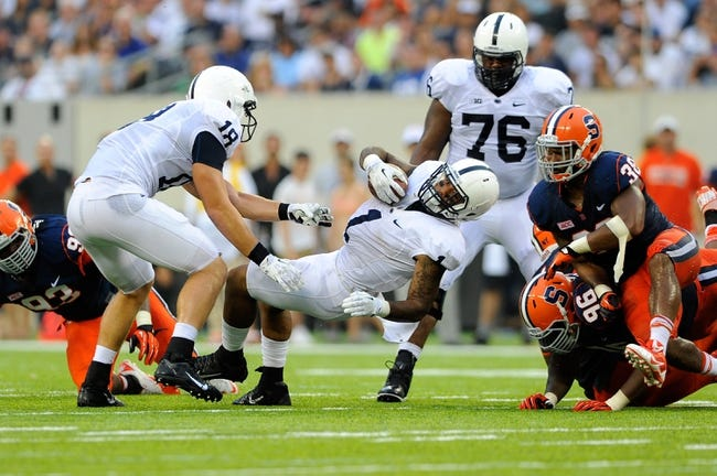 Aug 31, 2013; East Rutherford, NJ, USA; Editors note: Caption correction) Penn State Nittany Lions running back Bill Belton (1) falls forward while running the ball during the third quarter against the Syracuse Orange at MetLife Stadium.  Penn State defeated Syracuse 23-17.  Mandatory Credit: Rich Barnes-USA TODAY Sports