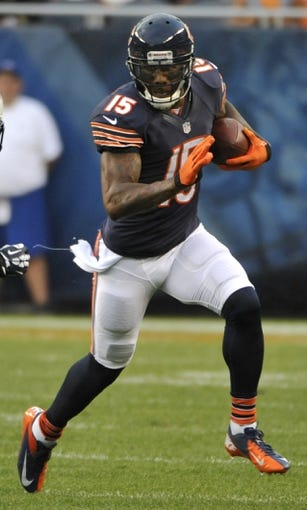 Aug 15, 2013; Chicago, IL, USA;  Chicago Bears wide receiver Brandon Marshall (15) runs with the ball during the first quarter at Soldier Field. Mandatory Credit: David Banks-USA TODAY Sports