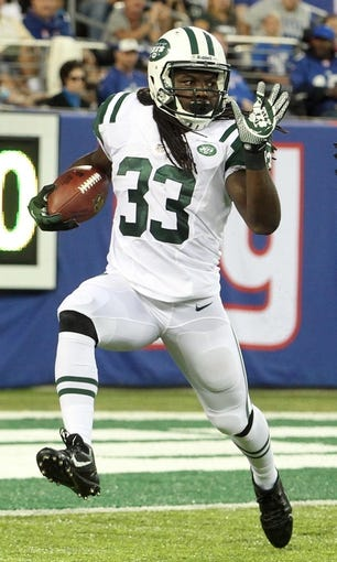 Aug 24, 2013; East Rutherford, NJ, USA; New York Jets running back Chris Ivory (33) runs during the first quarter of a preseason game at MetLife Stadium. Mandatory Credit: Brad Penner-USA TODAY Sports