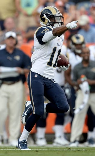 Aug 24, 2013; Denver, CO, USA; St. Louis Rams wide receiver Tavon Austin (11) runs for a gain during a kickoff against the Denver Broncos at Sports Authority Field . Mandatory Credit: Ron Chenoy-USA TODAY Sports