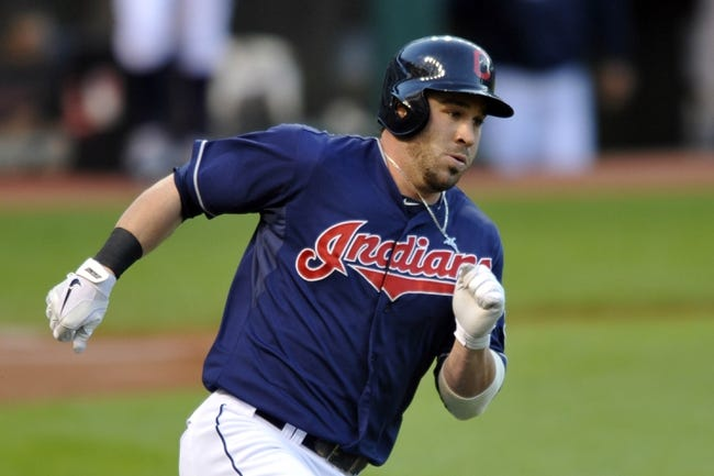 Sep 3, 2013; Cleveland, OH, USA; Cleveland Indians second baseman Jason Kipnis (22) rounds first base on a double in the first inning against the Baltimore Orioles at Progressive Field. Mandatory Credit: David Richard-USA TODAY Sports