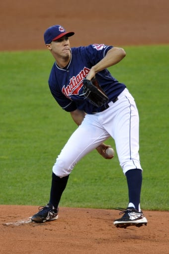 Sep 3, 2013; Cleveland, OH, USA; Cleveland Indians starting pitcher Ubaldo Jimenez (30) delivers in the first inning against the Baltimore Orioles at Progressive Field. Mandatory Credit: David Richard-USA TODAY Sports