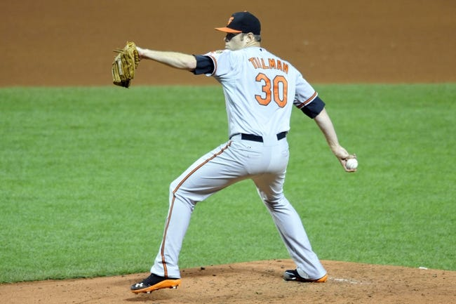 Sep 3, 2013; Cleveland, OH, USA; Baltimore Orioles starting pitcher Chris Tillman (30) delivers in the fourth inning against the Cleveland Indians at Progressive Field. Mandatory Credit: David Richard-USA TODAY Sports