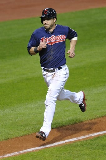 Sep 3, 2013; Cleveland, OH, USA; Cleveland Indians second baseman Jason Kipnis (22) scores a run in the fourth inning against the Baltimore Orioles at Progressive Field. Mandatory Credit: David Richard-USA TODAY Sports