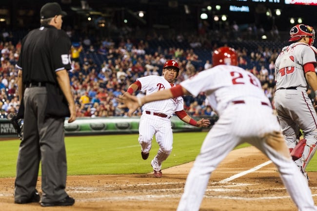 Sep 3, 2013; Philadelphia, PA, USA; Philadelphia Phillies catcher Carlos Ruiz (51) scores during the fourth inning against the Washington Nationals at Citizens Bank Park. Mandatory Credit: Howard Smith-USA TODAY Sports