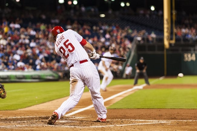 Sep 3, 2013; Philadelphia, PA, USA; Philadelphia Phillies third baseman Cody Asche (25) hits a two RBI single during the fourth inning against the Washington Nationals at Citizens Bank Park. Mandatory Credit: Howard Smith-USA TODAY Sports