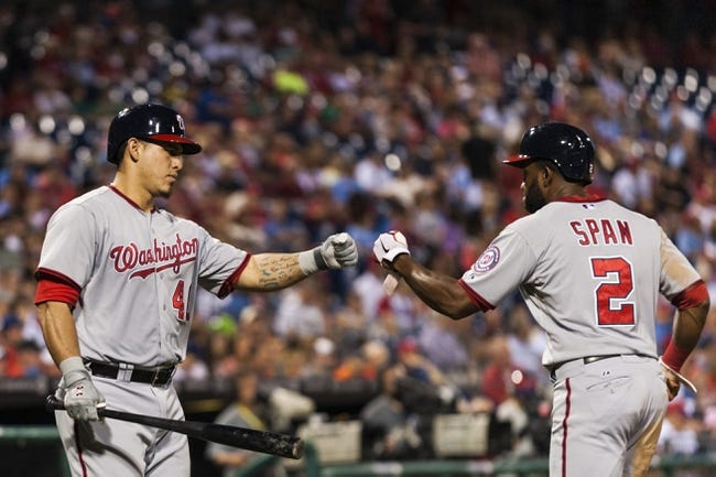 Sep 3, 2013; Philadelphia, PA, USA; Washington Nationals center fielder Denard Span (2) celebrates scoring with catcher Wilson Ramos (40) during the fifth inning against the Philadelphia Phillies at Citizens Bank Park. Mandatory Credit: Howard Smith-USA TODAY Sports