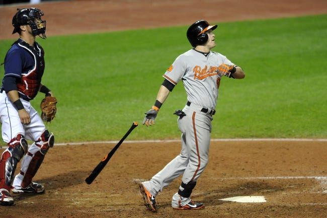 Sep 3, 2013; Cleveland, OH, USA; Baltimore Orioles left fielder Nate McLouth (right) watches his three-run home run in the ninth inning against the Cleveland Indians at Progressive Field. Mandatory Credit: David Richard-USA TODAY Sports