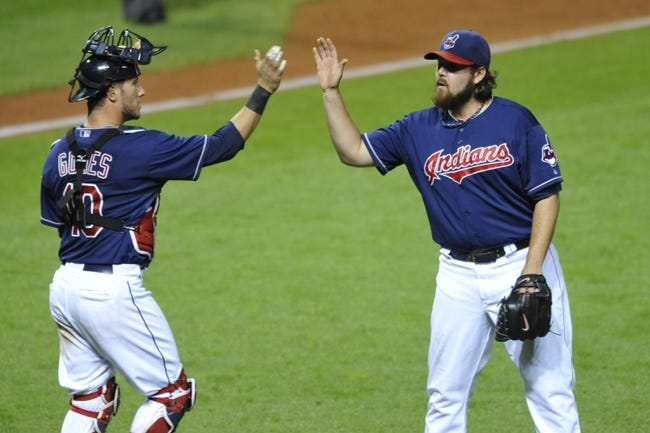 Sep 3, 2013; Cleveland, OH, USA; Cleveland Indians catcher Yan Gomes (10) and relief pitcher Chris Perez (54) celebrate a 4-3 win over the Baltimore Orioles at Progressive Field. Mandatory Credit: David Richard-USA TODAY Sports