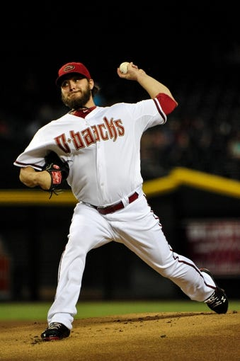 Sept 3, 2013; Phoenix, AZ, USA; Arizona Diamondbacks starting pitcher Wade Miley (36) throws during the first inning against the Toronto Blue Jays at Chase Field. Mandatory Credit: Matt Kartozian-USA TODAY Sports