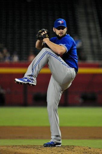 Sept 3, 2013; Phoenix, AZ, USA; Toronto Blue Jays starting pitcher Todd Redmond (58) throws during the first inning against the Arizona Diamondbacks at Chase Field. Mandatory Credit: Matt Kartozian-USA TODAY Sports