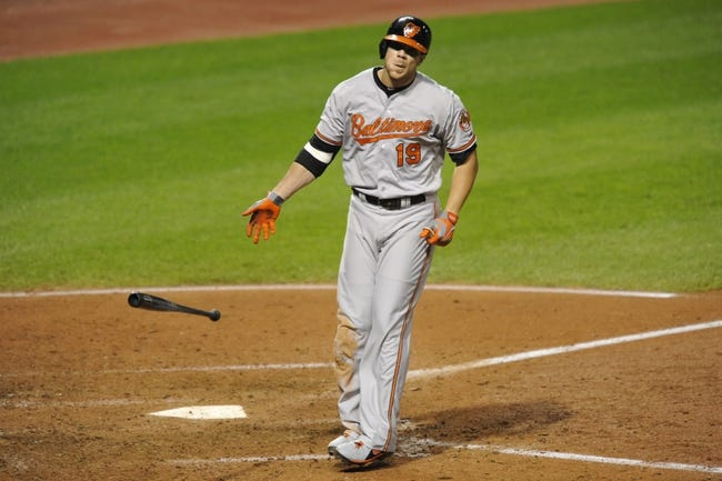 Sep 3, 2013; Cleveland, OH, USA; Baltimore Orioles first baseman Chris Davis (19) drops his bat after walking in the eighth inning against the Cleveland Indians at Progressive Field. Mandatory Credit: David Richard-USA TODAY Sports