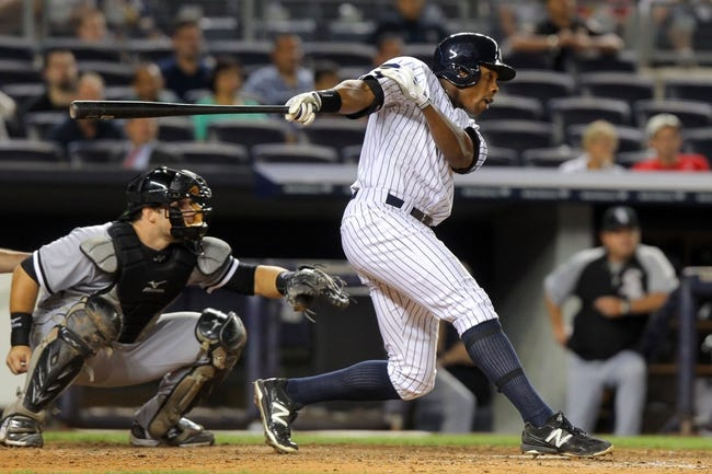 Sep 3, 2013; Bronx, NY, USA; New York Yankees right fielder Curtis Granderson (14) hits a game-tying RBI single against the Chicago White Sox during the eighth inning of a game at Yankee Stadium. Mandatory Credit: Brad Penner-USA TODAY Sports