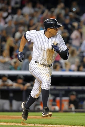 Sep 3, 2013; Bronx, NY, USA; New York Yankees third baseman Alex Rodriguez (13) singles against the Chicago White Sox during the eighth inning of a game at Yankee Stadium. Mandatory Credit: Brad Penner-USA TODAY Sports