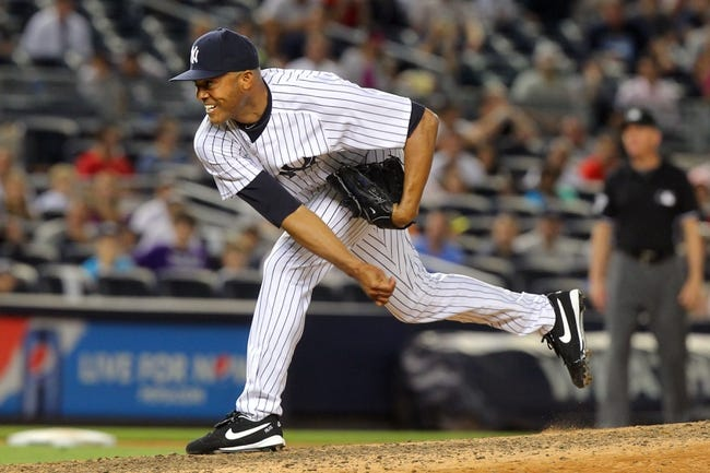 Sep 3, 2013; Bronx, NY, USA; New York Yankees relief pitcher Mariano Rivera (42) pitches against the Chicago White Sox during the ninth inning of a game at Yankee Stadium. Mandatory Credit: Brad Penner-USA TODAY Sports