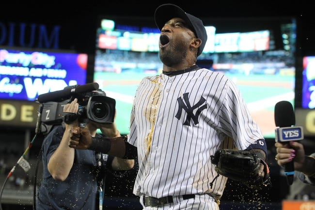 Sep 3, 2013; Bronx, NY, USA; New York Yankees shortstop Eduardo Nunez (26) reacts after being doused after a game against the Chicago White Sox at Yankee Stadium. Mandatory Credit: Brad Penner-USA TODAY Sports