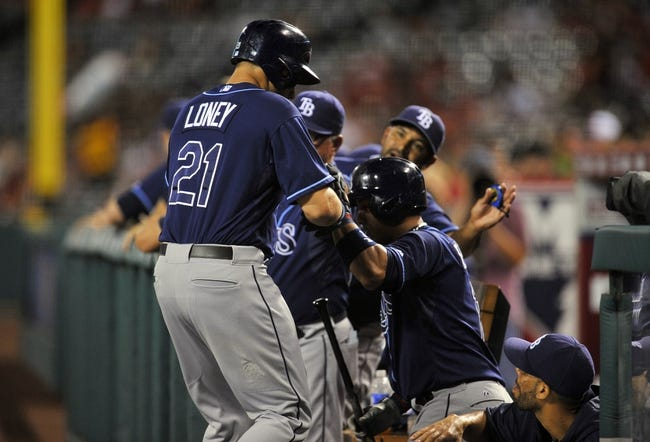 September 3, 2013; Anaheim, CA, USA; Tampa Bay Rays first baseman James Loney (21) is congratulated after scoring a run in the second inning against the Los Angeles Angels at Angel Stadium of Anaheim. Mandatory Credit: Gary A. Vasquez-USA TODAY Sports