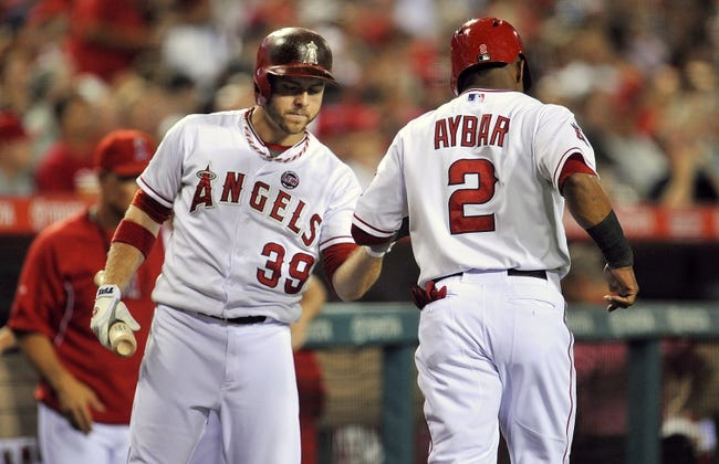 September 3, 2013; Anaheim, CA, USA; Los Angeles Angels shortstop Erick Aybar (2) is congratulated by left fielder J.B. Shuck (39) after scoring a run in the second inning against the Tampa Bay Rays at Angel Stadium of Anaheim. Mandatory Credit: Gary A. Vasquez-USA TODAY Sports
