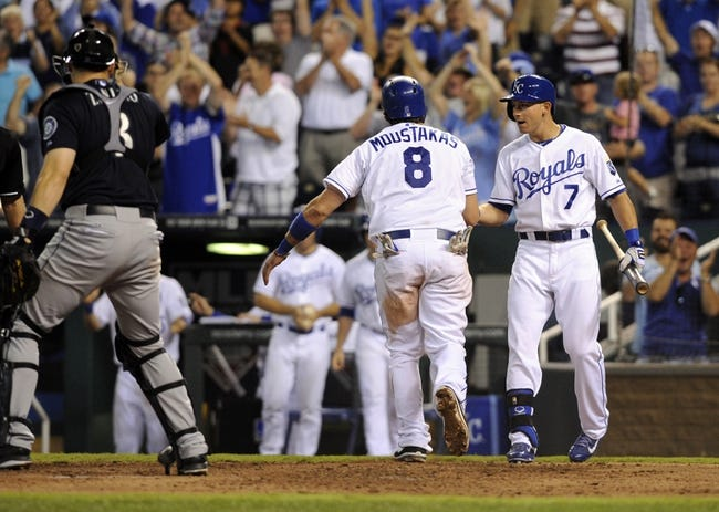 Sep 3, 2013; Kansas City, MO, USA; Kansas City Royals third baseman Mike Moustakas (8) is congratulated by right fielder David Lough (7) after scoring against the Seattle Mariners in the eight inning at Kauffman Stadium. The Royals won the game 4-3. Mandatory Credit: John Rieger-USA TODAY Sports