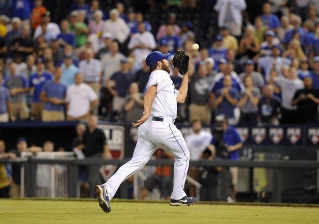 Sep 3, 2013; Kansas City, MO, USA; Kansas City Royals relief pitcher Greg Holland (56) catches a bunt attempt by Seattle Mariners shortstop Brad Miller (not pictured) in the ninth inning at Kauffman Stadium. The Royals won the game 4-3. Mandatory Credit: John Rieger-USA TODAY Sports