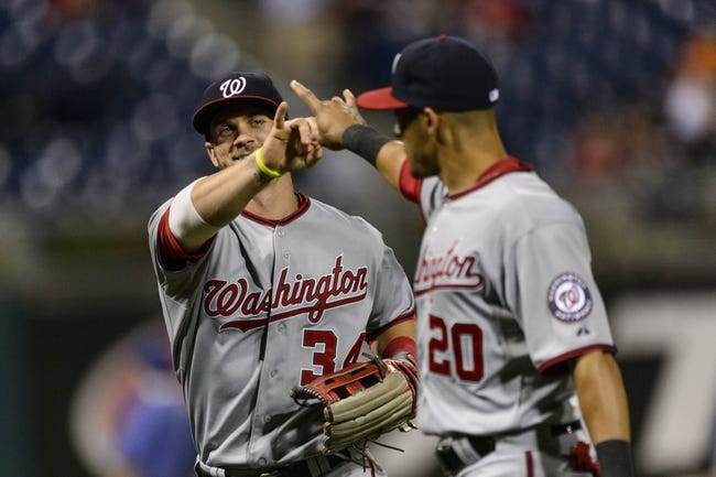 Sep 3, 2013; Philadelphia, PA, USA; Washington Nationals left fielder Bryce Harper (34) and shortstop Ian Desmond (20) hold up two fingers as they come off the field during the eighth inning against the Philadelphia Phillies at Citizens Bank Park. The Nationals defeated the Phillies 9-6. Mandatory Credit: Howard Smith-USA TODAY Sports