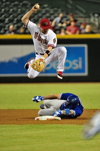 Sept 3, 2013; Phoenix, AZ, USA; Arizona Diamondbacks second baseman Aaron Hill (2) forces out Toronto Blue Jays third baseman Brett Lawrie (13) at second base during the first inning at Chase Field. Mandatory Credit: Matt Kartozian-USA TODAY Sports